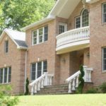 brick house with baluster railing