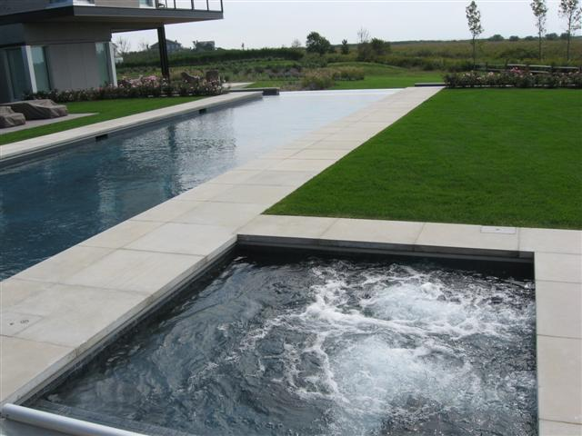 modern style infinity pool with spa