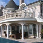 masonry home with  baluster railing