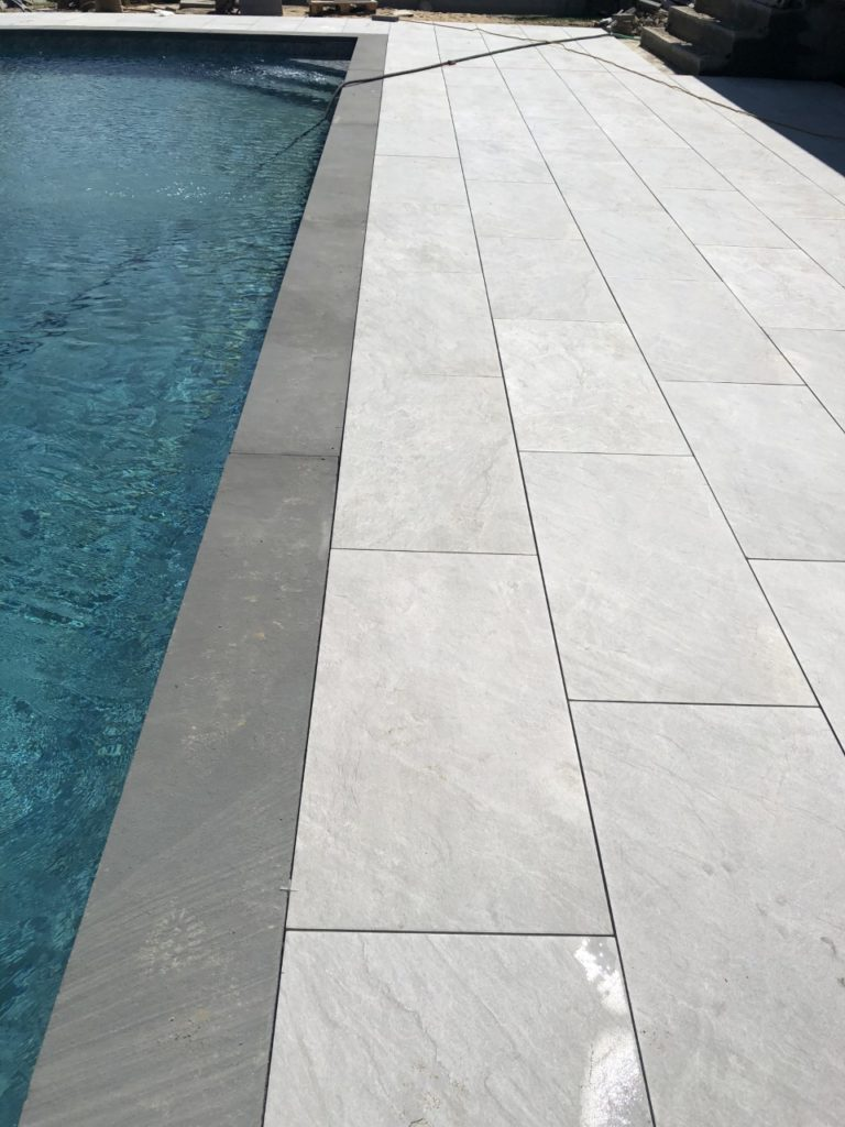 blue stone square edge with tan rectangular stones