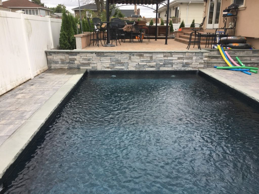bluestone with rockface pool and patio