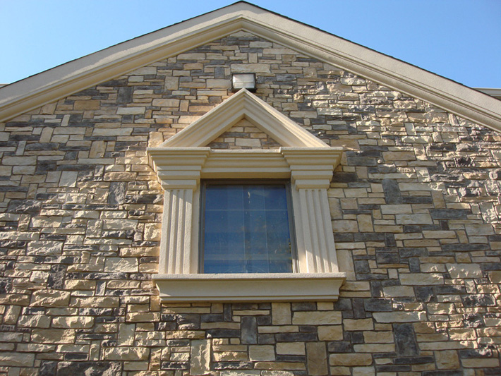stone window with stone face